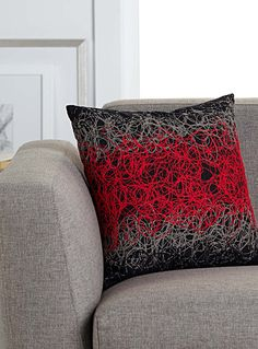 Exclusively from Simons Maison     Fun and modern blend of threads sewn in textured abstract shapes, arranged in graded urban colours.    Fashionable, decorative black, grey and bright red combination   Washable with removable cover   40 x 40 cm