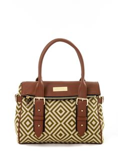 Spartina puts a chic spin on the satchel trend! Elegance meets style and function in this wonderful new handbag. A beautiful all-leather flap folds over the top and closes with a magnetic strap. The surprise is that the flap doubles as a deep pocket sleeve that extends the length of the bag. Rich details include decorative leather appointments including buckles and gold pegs that add an exquisite finishing touch.