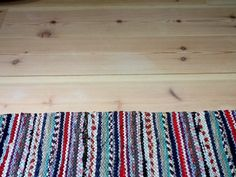 New wooden floor and a Finnish rug. So happy!