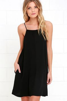 The Clarion Call Black Dress has issued an urgent order ... to go hit the dance floor and have a good time! A high, apron neckline (supported by adjustable spaghetti straps) tops off this woven poly swing dress. Hidden side pockets.