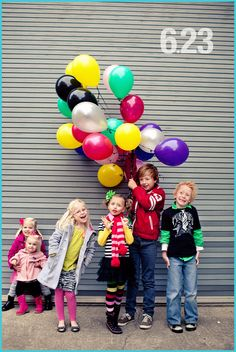 Have one of the kids holding a big bunch if balloons in gray, hot pink, or navy