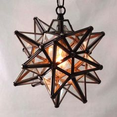 """The Moravian Star Pendant light is a classic choice for the porch; My Danilo imports a wide array of sizes and styles from Mexico and hand-wires them in Lynn, Massachusetts, to create UL-listed pendant lights; prices start at $92 for a 9-Inch Glass Star."""
