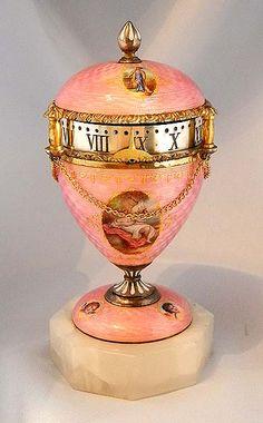 Charming small silver gilt and enamel 8-day annular dial urn clock circa 1890.