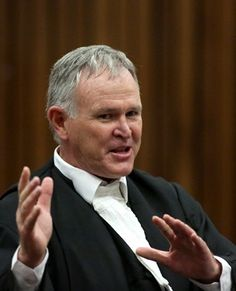 Advocate  Barry Roux. as he unwraps the mystery of Law as he try to put it to the house that his client Oscar Pistorious is innocent  of all the charged pressed against him