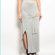 Gray wrap asymmetrical slit maxi skirt Gray wrap maxi skirt with asymmetrical slit. Rayon and viscose. Brand new from vendor, does not have tags. S, M, L available. Please ask me to make you a separate listing for purchase, this listing is for multiple sizes. DO NOT PURCHASE THIS LISTING. Coming soon! Skirts Maxi