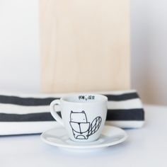 White originally designed and hand-painted espresso cup. PATTERN: BEAVER  volume 100ml cup ↔ width 6,5cm + 2cm ear ↕ height 6cm saucer ↔ width 12cm  Decorate your kitchen and get creative with the kitchen accosseries. FOR.REST equals minimalistic design for your interiors. White porcelain is a...