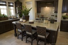 Kitchen Counter Height Rattan Bar Stools In A Dark Finish With Woven Backrests And