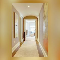 """""""Vaulting the ceiling of an otherwise narrow hallway, gives it a sense of breadth and height; a runner in the same color family as the nursery's wall-to-wall carpeting helps lead the eye into the larger space."""" #CohlerOnDesign #InteriorDesign #EricCohler #ECD"""