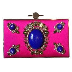 """4XHP Jason Wu Pink Silk Embellished Clutch Jason Wu hot-pink Karlie satin clutch.  Detachable chain shoulder strap. Cobalt-blue stone and clear and light-green crystal embellishment at front, gold-tone frame Internal patch pocket, designer-stamped plaque.  Fully lined in black leather.  Width 5"""" / 13.5cm Height 3"""" / 8cm Depth 2"""" / 5cm Handle Drop 24"""" / 61cm. Bag has never been worn but has a few scratches on the blue stones (see image). No trades, no PayPal. 10% off bundles. Jason Wu Bags…"""