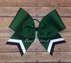 This custom bow is made from 3 wide grosgrain forest green ribbon. It includes a white glitter stripe and a black glitter stripe at the bottom of