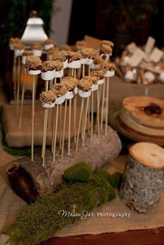 Love these marshmallows on a stick. Drill holes into the log to create a stand for them.