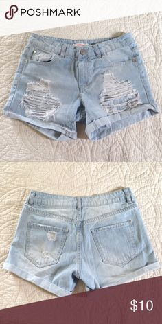 High waisted ripped shorts Light wash ripped shorts. Says they're  size 4 on the shorts but they are quite loose so it might even fit a size 6. Worn once. (Don't forget to bundle and save) refuge Shorts Jean Shorts