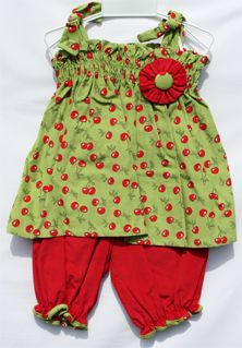 visit http://facebook.com/childrenscastleboutique on Tuesday nights at 8:00 PM CST for Sales ang Great Deals on children's boutique clothing.  Clothing is available in sizes 12 Months to 24Mo.Click on the word facebook above to preview our page. Baby girls strap dress is green with red cherries with red bloomers.