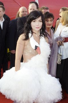 """Eccentric Icelandic songstress Björk arrived at the 2001 Oscars in an outfit that ruffled a few feathers: the now infamous swan dress designed by Marjan Pejoski. Björk, who was nominated that year for Best Original Song for """"I've Seen It All,"""" explained that she had also """"brought six ostrich eggs with me, and I was dropping them carefully on the red carpet. But other people's bodyguards kept picking them up and saying in their thick American accents, 'Scuse me, ma'am, you dropped this.'"""" The…"""