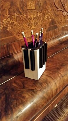 A pencil holder made with real piano keys.