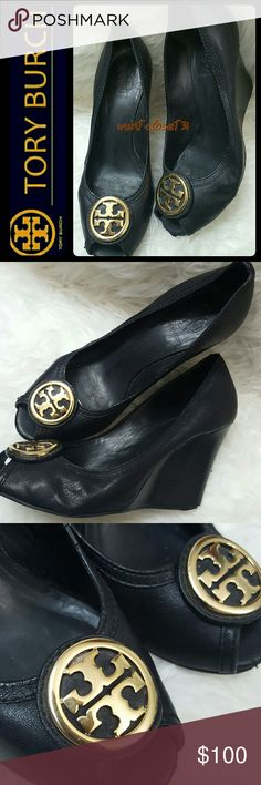 Tory Burch Leather Wedge Pumps Tory Burch Signature Shoes in Classic Elegance of Black Leather Peep Toe Style Wedge Pumps! Features the Iconic Tory Burch Emblem Logo in Gold on Vamp! So Classic Yet So Sassy and Trendy!   Made in Brazil with Leather Upper and Lining! Very Well Loved with Signs of Wear as Shown on Pics, Nicks on Inner Left Side of Sole, Some Wear on Heel, Used in Still Good Condition with Lots of Life Left! Size 7 1/2M Tory Burch Shoes Wedges