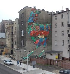 Aryz uses brushes, sprays and rollers to paint giant murals. Recently painted a mural in Poland in collaboration with OsGêmeos.