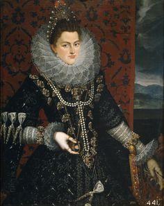 1598, Isabel Clara Eugenia. Os ornamentos preciosos são amplamente presentes na indumentária feminina e masculina, utilizam-se para apertar peças de vestuário,para unir faixas de tecido e para decorar o conjunto.São muito comuns as pérolas,sendo que nesta época começam a haver as primeiras réplicas.