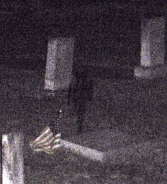 This mysterious photo was taken in a cemetery and shows a small shadow figure standing in front o...
