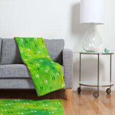 Kangarui Dreamy Giraffe Fleece Throw Blanket | DENY Designs Home Accessories #giraffe #blanket #homeware #green