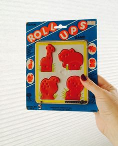 A personal favorite from my Etsy shop https://www.etsy.com/listing/266853205/safari-roll-ups-zoo-animals-game-1979