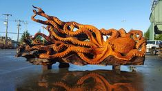 Jeffrey Michael Samudosky just took woodworking to a whole new level with this massive octopus sculpture. The Washington-based woodcarver started his company JMS Wood Sculpture in 1998 and since then he's been creating detailed works from Pacific Northwest trees. His latest is a replica of the Enteroctopus dofleini aka Giant Pacific Octopus. The sculpture was carved from a fallen Redwood given provided by Redwood Burl. The detail is absolutely phenomenal! Check it out below and find more ...