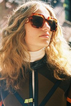 Anna Mila, 20, in a vintage coat, Gucci cream turtleneck and sunglasses. Produced by Vogue for Gucci.