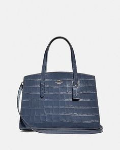A study in everyday style, the Charlie Carryall is spacious in design and lightweight in feel. The distinctive crocodile-embossed leather silhouette features an organized, thoughtful interior perfect from day to night. It fits a laptop. Coach Handbags, Tote Handbags, Coach Bags, Designer Totes, Designer Handbags, Coach Leather Cleaner, Bag Sale, Womens Tote Bags, Pebbled Leather