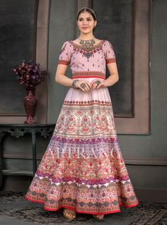 5995d2eaaa2 Add richer looks to a personality with this surpassing multi colour fancy  fabric designer gown. The embroidered and print work on dress personifies  the ...