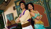 Aladdin and Princess Jasmine standing back-to-back in Adventureland at Magic Kingdom park