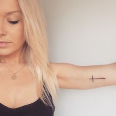 Cross tattoo. Arm tattoo. Small cross. Inner arm tattoo.