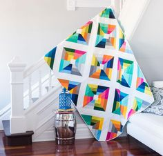 """Delightfully vibrant """"Kite Flight"""" quilt from Kona Cotton. Quilt kit (including pattern) available after the jump."""