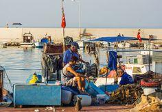 Fishermen in the harbor Altinoluk, Turkey