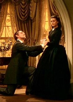 """Gone With the Wind"", 1939 ~ Rhett Butler (played by Clark Gable) proposes to Scarlett O'Hara (played by Vivien Leigh)."