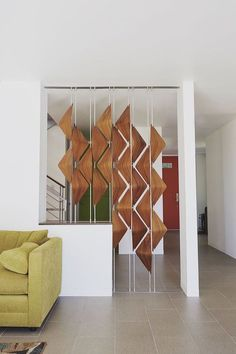 Awesome Room Divider Ideas For Your Small Space Home Designs The new and trendy way to divide a room is modern room dividers. This innovative system allows you to reduce the space in a room. It lets you create a. Living Room Partition, Living Room Divider, Room Partition Designs, Glass Room Divider, Diy Room Divider, Divider Ideas, Decorative Room Dividers, Wooden Room Dividers, Bookshelf Room Divider