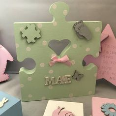 Cute freestanding plaque bearing your childs name. Adorned with a selection from mini wooden hearts, butterflies, babies feet, buttons, bows, mini jigsaw pieces, and stars. Date of birth or Christening date, and babys weight at birth may also be included for no extra charge. A lovely