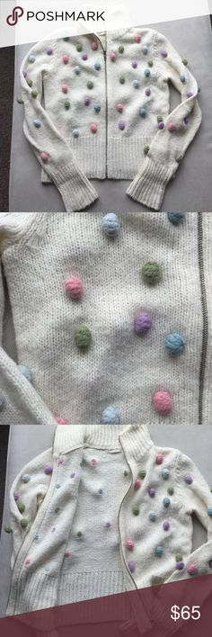 Sleeping on Snow zip up snowball Christmas sweater Acrylic/wool/ nylon blend.  Dry clean only.  Cream colored zip up sweater with multicolored Pom poms throughout.  Excellent condition.  Prepare for compliments 😀😀 Anthropologie Sweaters Cardigans