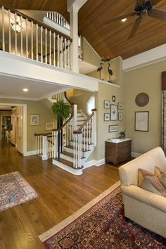 dark steps, lighter wood flooring. Wall color. Chest of drawers by stairs. LOVE OPEN FEEL