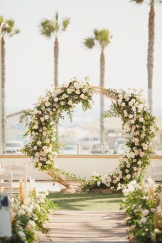 Waterfront California beach wedding floral arch. Floral arch beach front California ceremony backdrop #floralarch #beachwedding