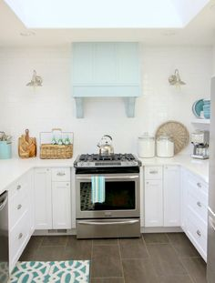 Gorgeous Coastal style white kitchen with aqua blue accents - DIY hood + subway tile to the ceiling