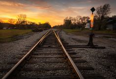 Tracks to the Sun by Nick Bristol on Capture Wisconsin // I made this picture last November on the railroad tracks at Lone Rock. I was hoping for a little color in the sky and it really turned out being better than I thought it would. I first figured out my comp while just holding the camera, then set the camera up on my tripod and after careful manual focusing I held a 2 stop grad filter in front of the lens to hold the sky and get a little more exposure on the foreground and tracks. It was...