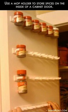 Got this from Facebook.  Use mop holders to hold spices on inside of cabinet door.