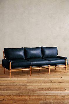Navy leather safari sofa. So finnnneeeeee.