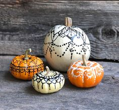 Unique ideas for no carve pumpkins; rustic metal, distressed copper, and henna pumpkin examples and ideas.