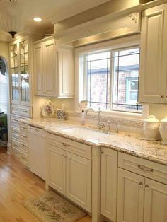 Love the antiqued cream cabinets and light countertop combo | For ...