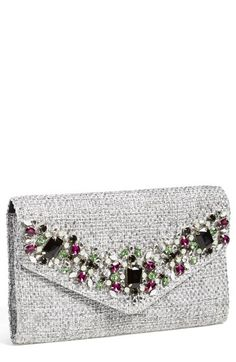 A garland of beads complements the metallic weave of a glamorous envelope clutch.