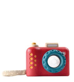 """The best part about this awesomly cute camera is the kaleidoscope lens. So kids get a different picture every time they look through the lens. With a sturdy cloth wrist strap. Camera body is made from eco-friendly, safe and sustainable recycled rubber wood, and colored with non-toxic, water based dyes.  Made in Thailand. Fair trade.   3.9"""" x 2"""" x 3.1"""""""
