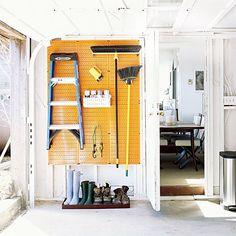 Garage + basement organization - a bright yellow pegboard from http:/www.wallcontrol.com $21/panel