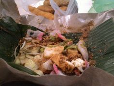 """"""" Lontong kacang """"  Lontong ( indonesian food made from rice ) with peanut sauce ( smashed )and.raw veges"""