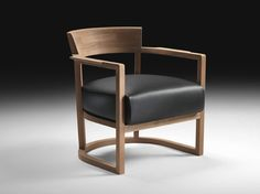 The elegant Barchetta chair features a mahogany frame with a semicircular structure.